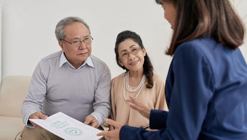 Insurance broker explaining life insurance Perth